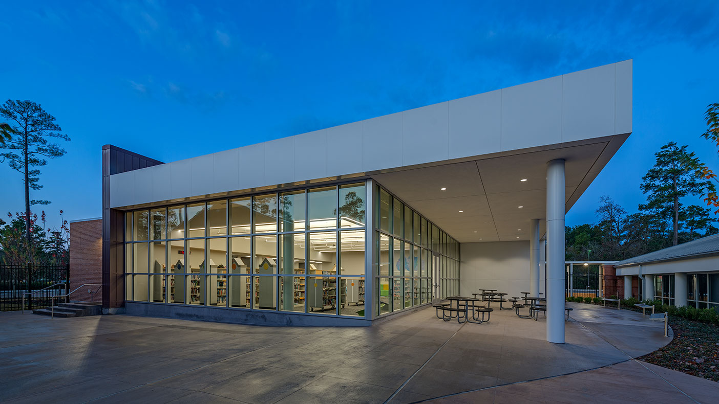 The new library features a full-height glass curtain wall system that takes advantage of natural light from the north.