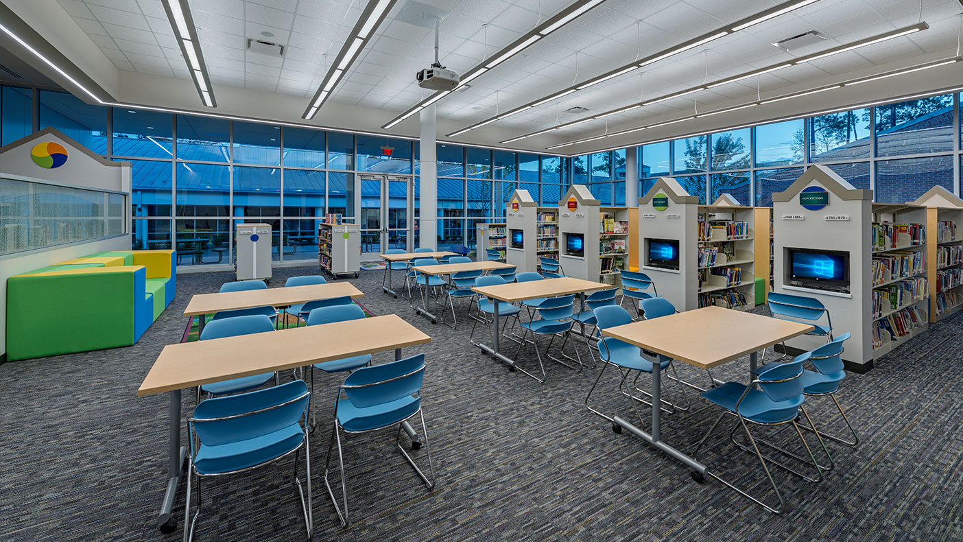 Book shelves were oriented with computers at the ends allowing the librarian to monitor computer usage and see down the aisles from the circulation desk.