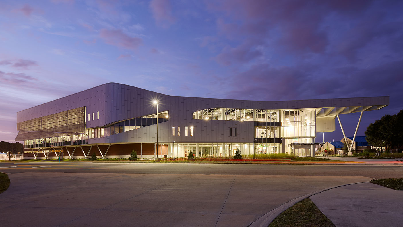 The exterior design incorporates a glazing pattern that symbolizes the university's osprey mascot.